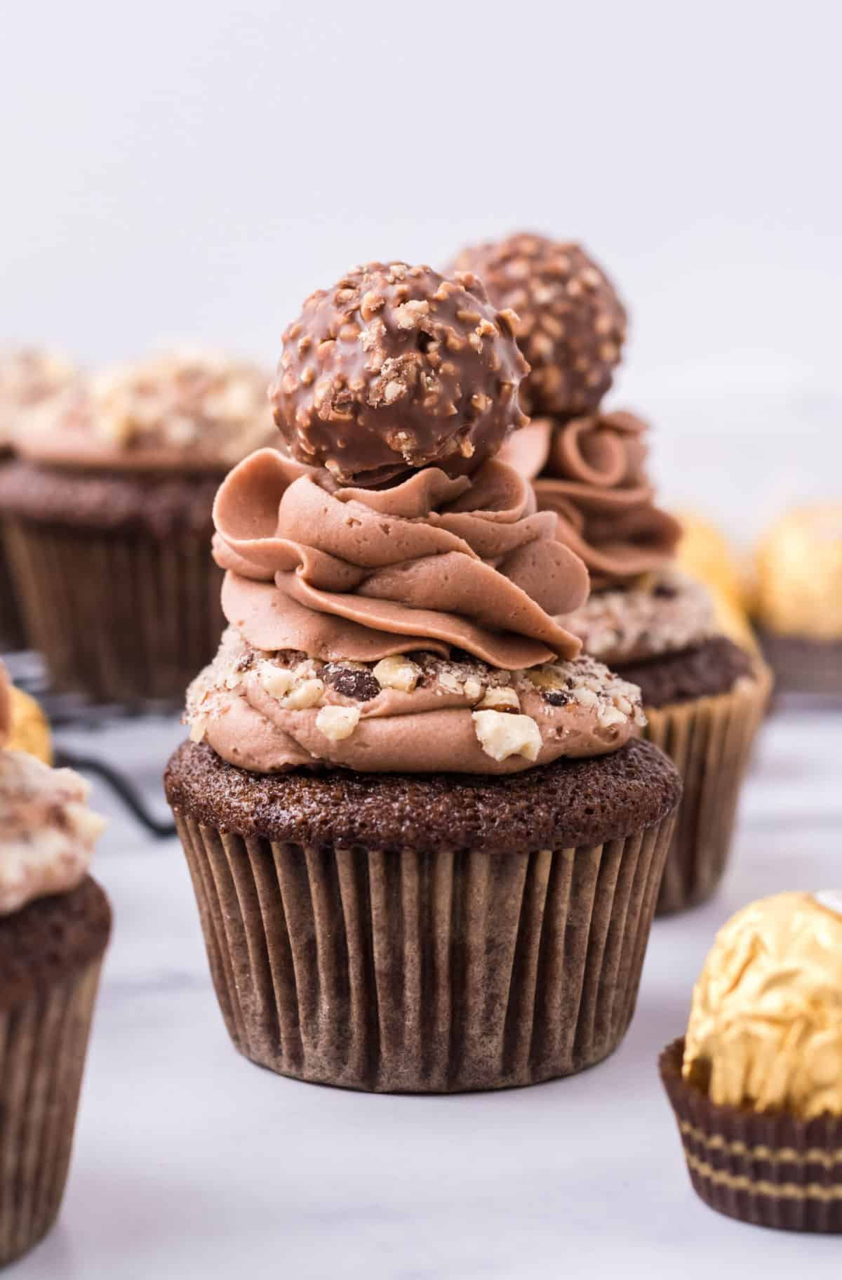 Ferrero rocher topped chocolate cupcake with chocolate frosting.