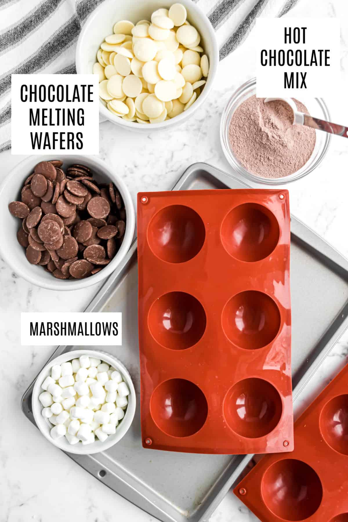 Ingredients needed to make hot chocolate bombs.