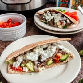 Beef gyro in pita with cucumber, tomato, onion, and tzatziki sauce.