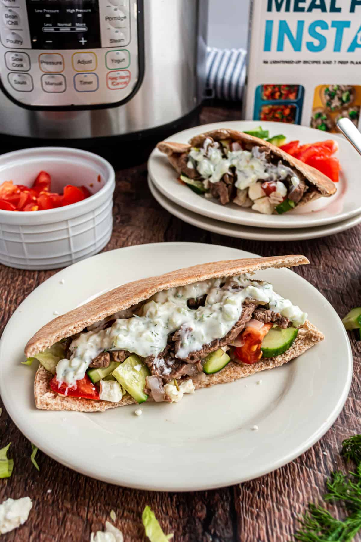 Beef gyro in pita with cucumber, tomato, onion, and tzatziki sauce.