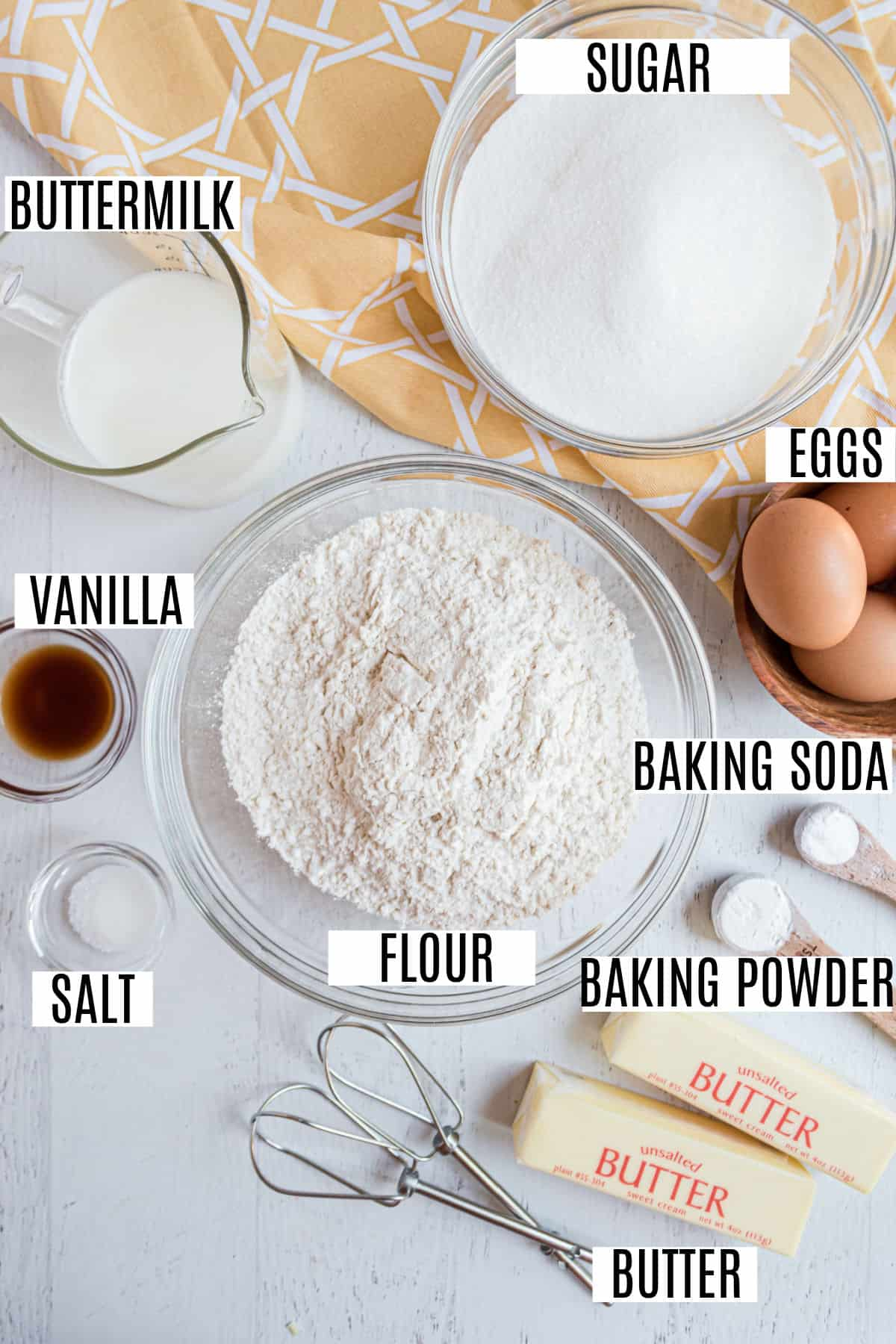 Ingredients needed to make kentucky butter cake, including buttermilk.