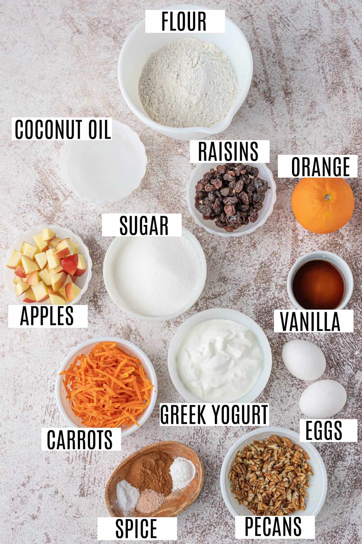 Ingredients needed for morning glory muffins including carrots, pecans, raisins, and apples.