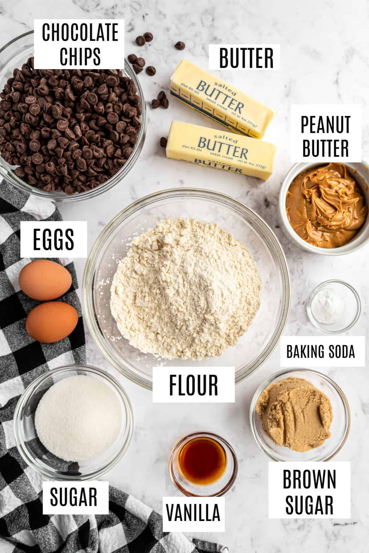 Ingredients needed to make peanut butter swirled chocolate chip cookie bars.