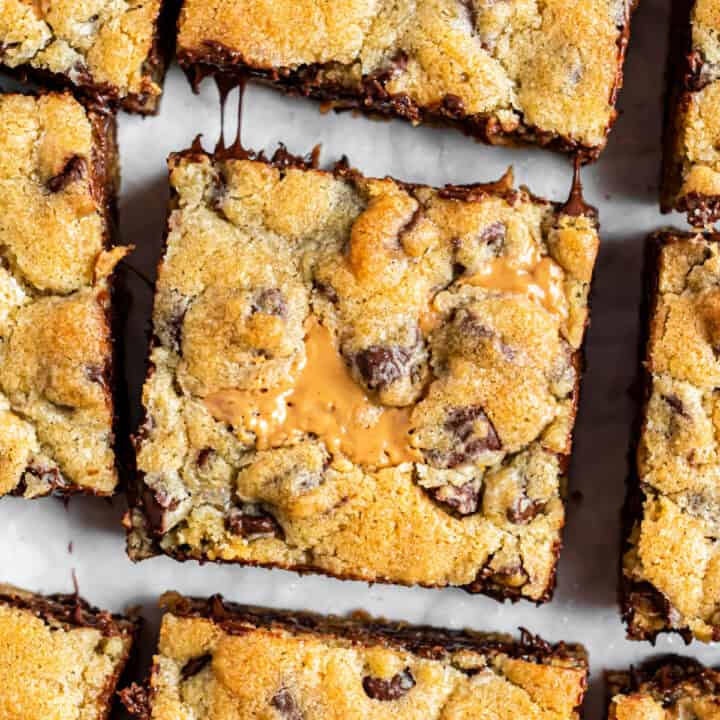 Square bars of peanut butter swirled chocolate chip cookies.
