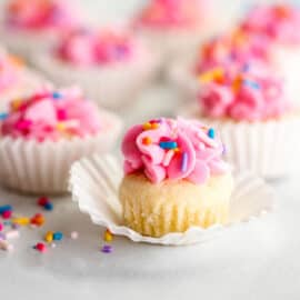 Pink frosted sugar cookies in a cupcake wrapper.
