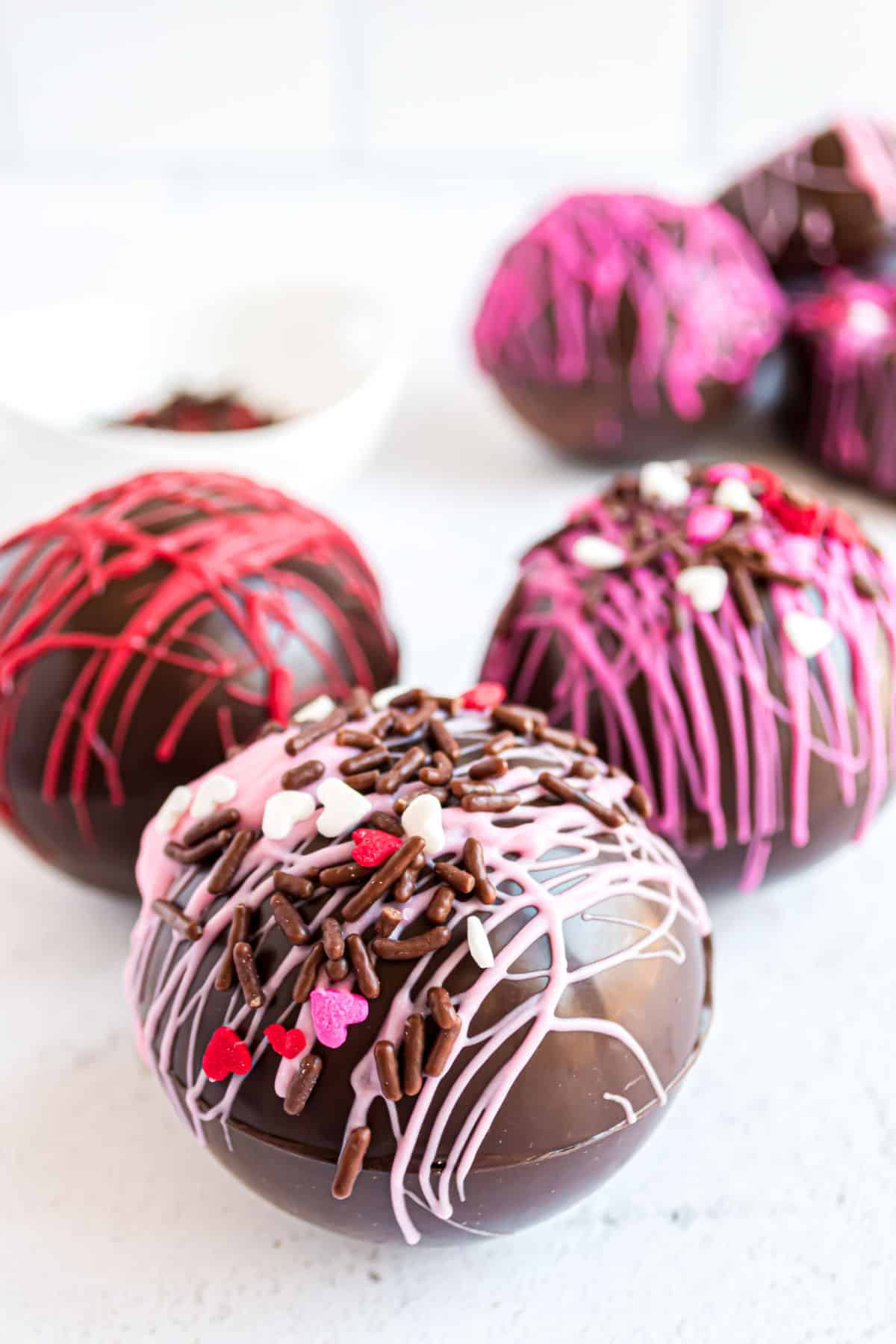 Valentine's day hot cocoa bombs made in sphere mold.