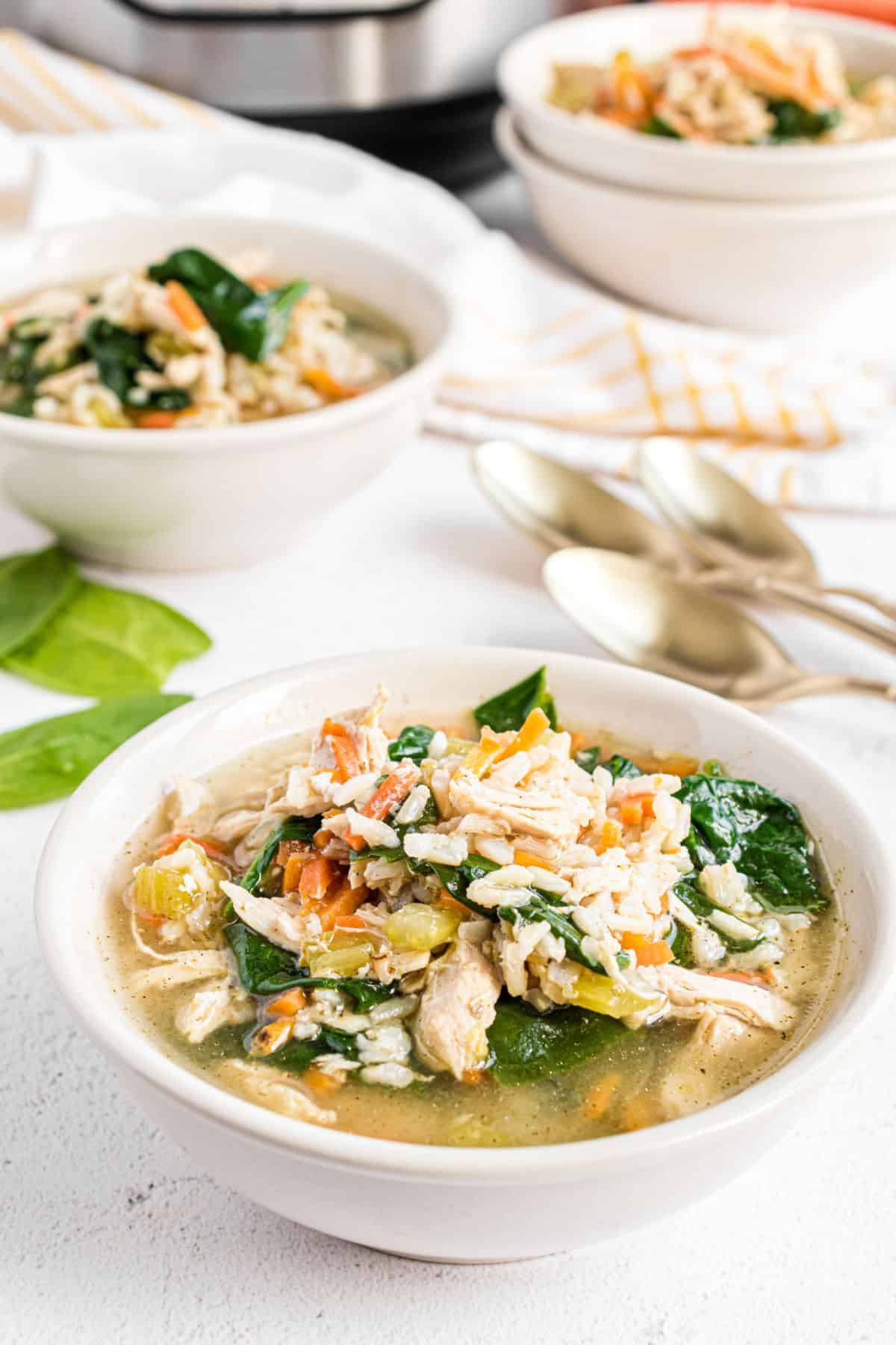 Soup bowl with chicken and rice soup with spinach.