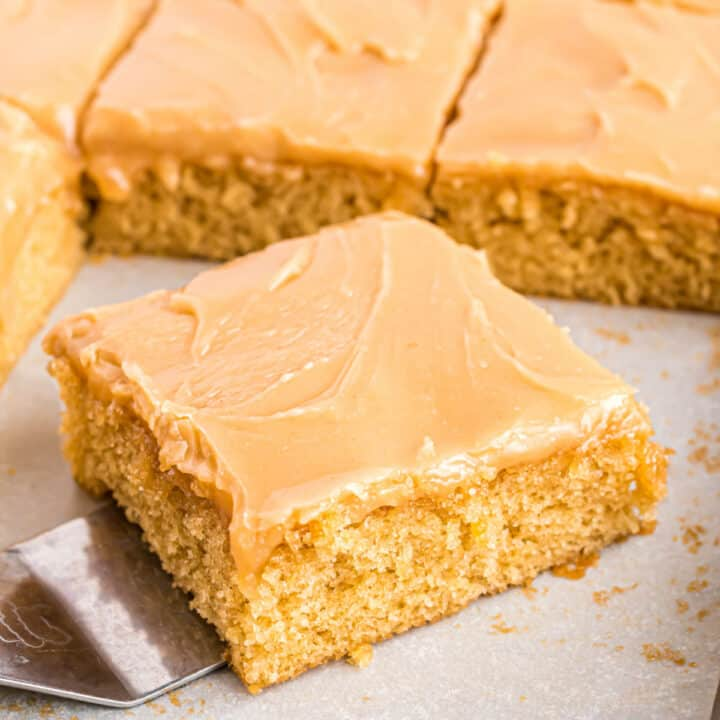 This Peanut Butter Sheet Cake is an unbelievably moist, rich, peanut butter cake with creamy peanut butter frosting poured on top. Similar to Texas Sheet Cake, but for the peanut butter lover instead!