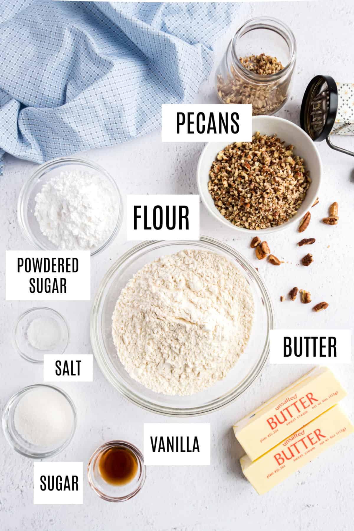Ingredients needed for pecan sandies cookies.