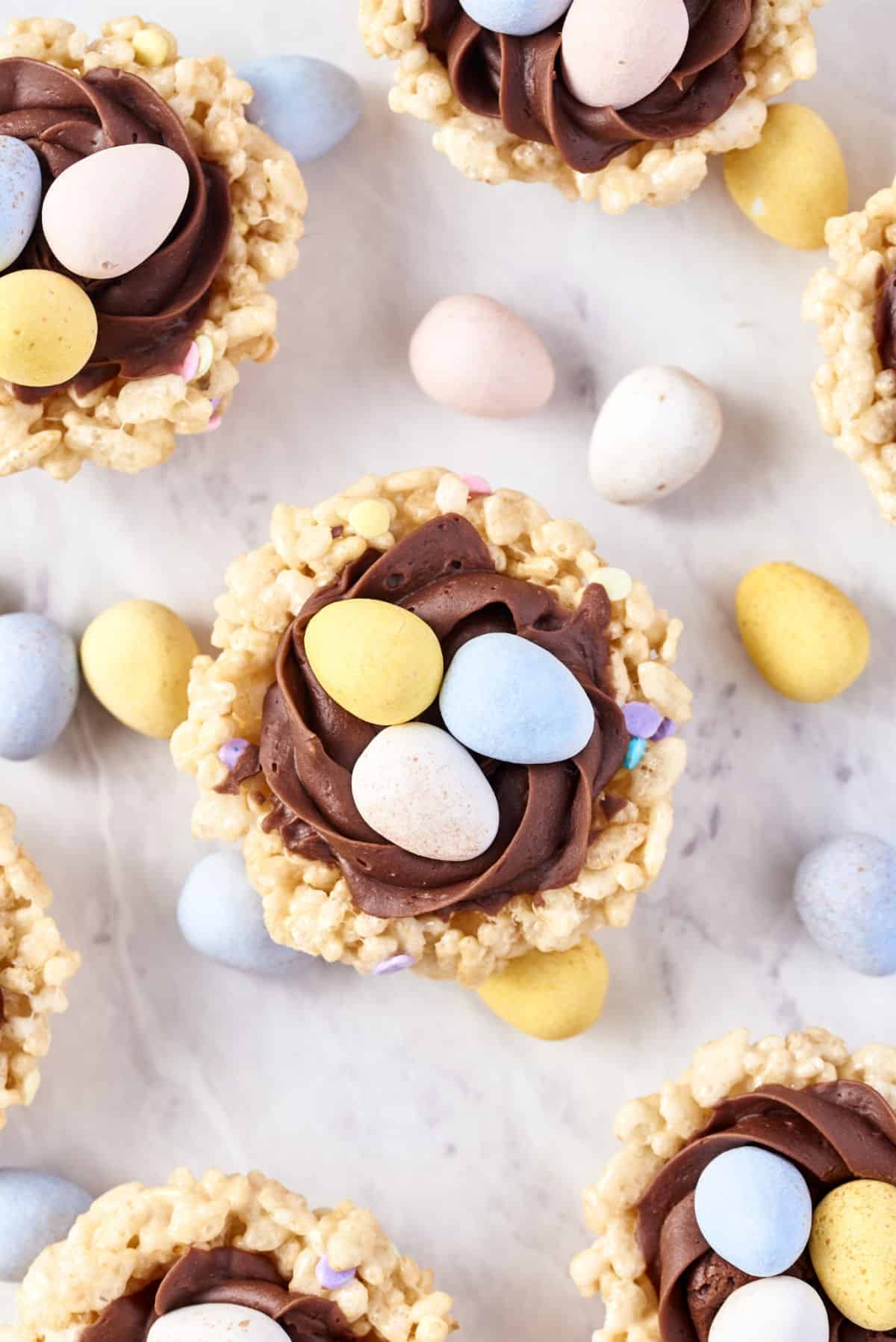 Overhead photos of easter egg nests made from rice krispie treats.