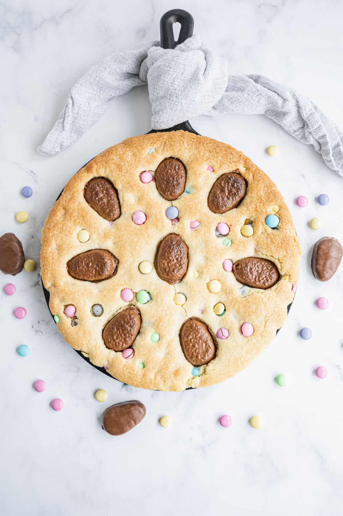 Sugar cookie cake baked in a skillet for Easter.