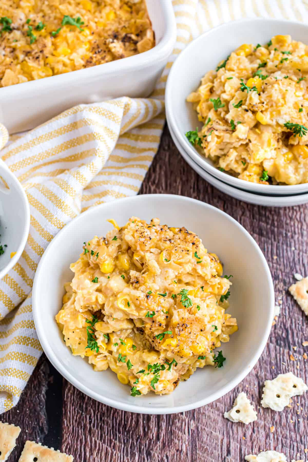 Corn casserole in small white bowls for serving.