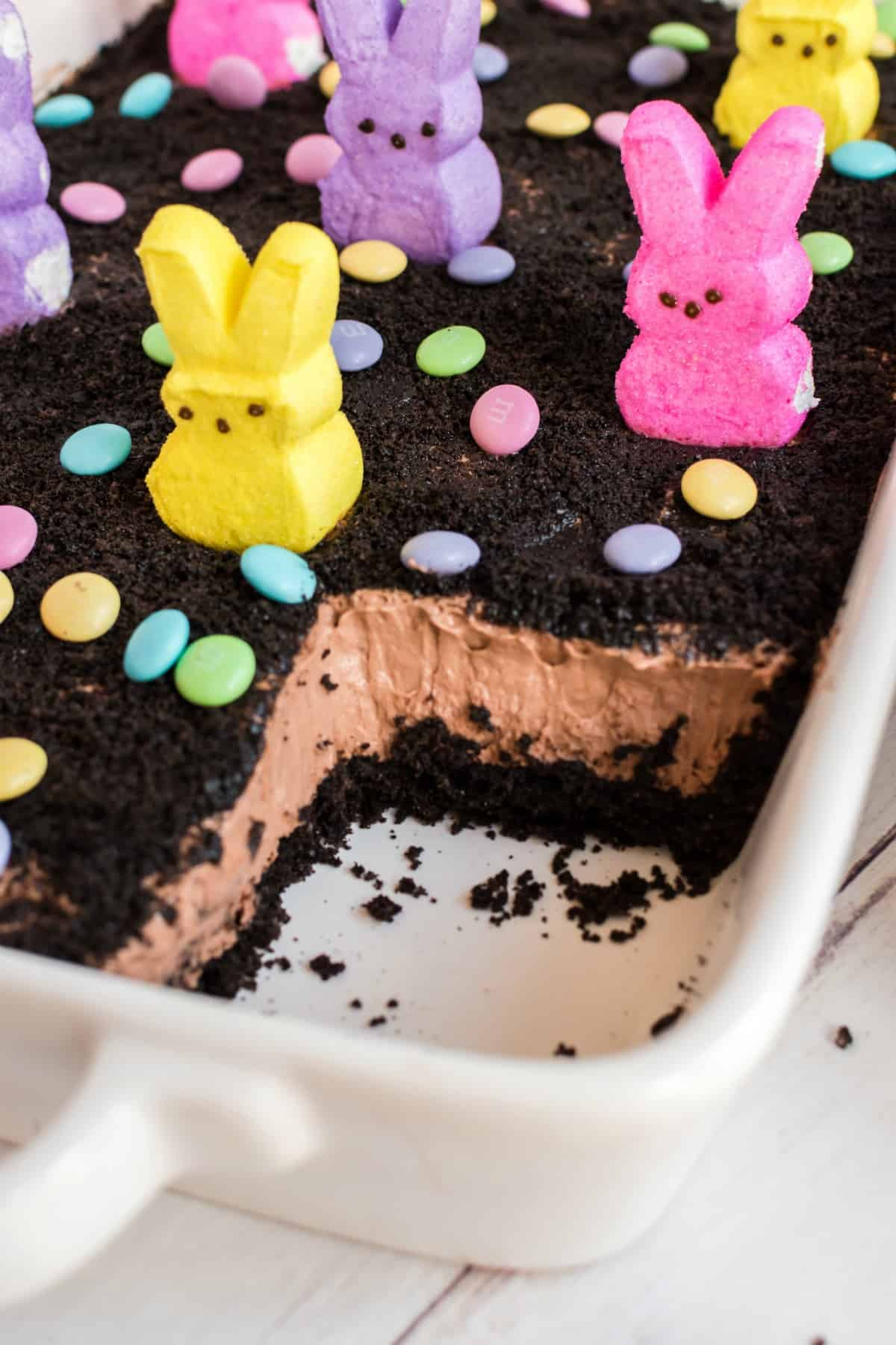 Easter dirt cake in a 13x9 baking dish with one slice removed.