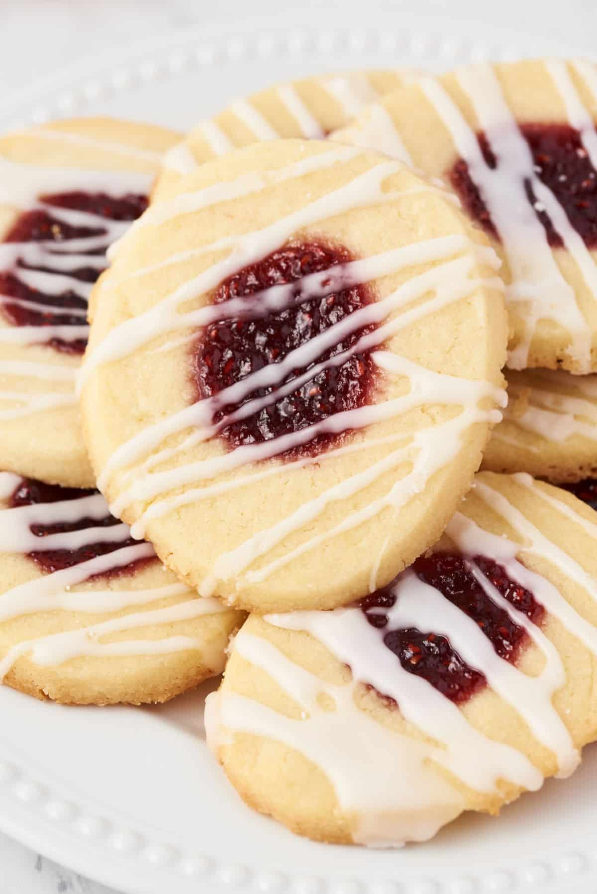 Thumbprint cookies with raspberry jam and vanilla icing drizzle.