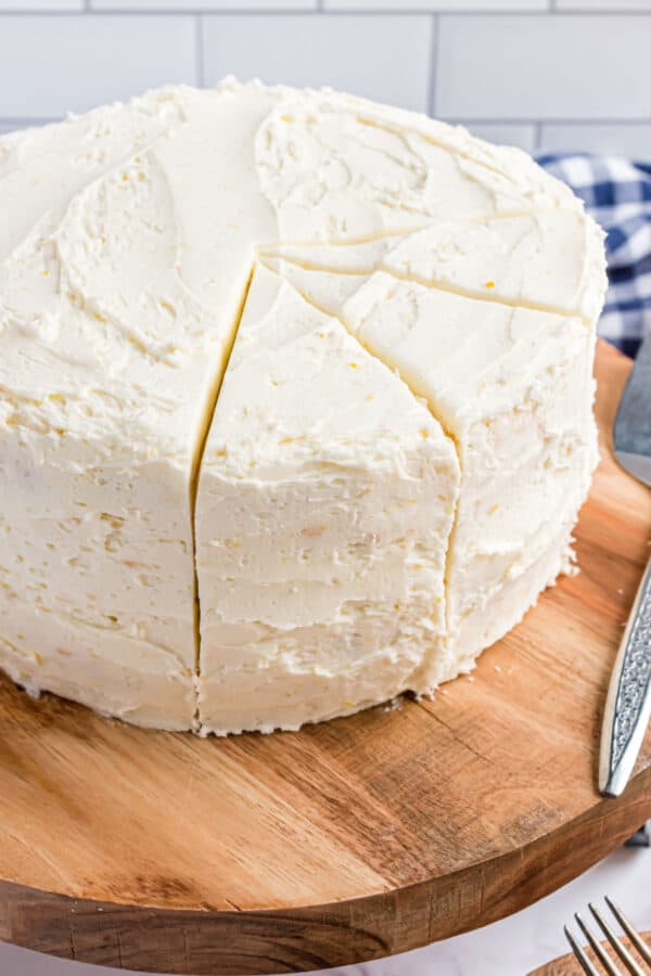 Layer cake covered in lemon frosting.