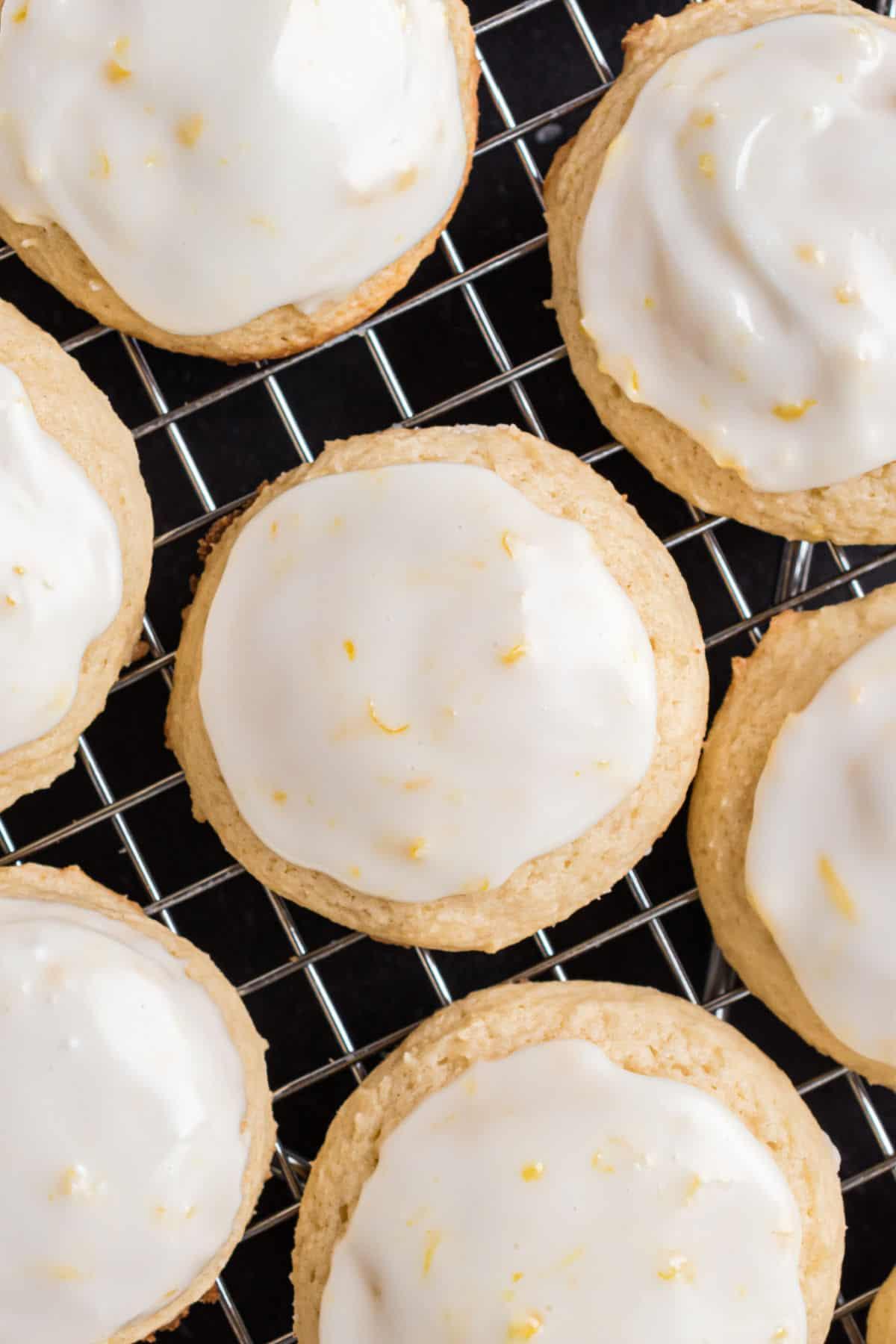 Lemon iced ricotta cookies on wire rack.