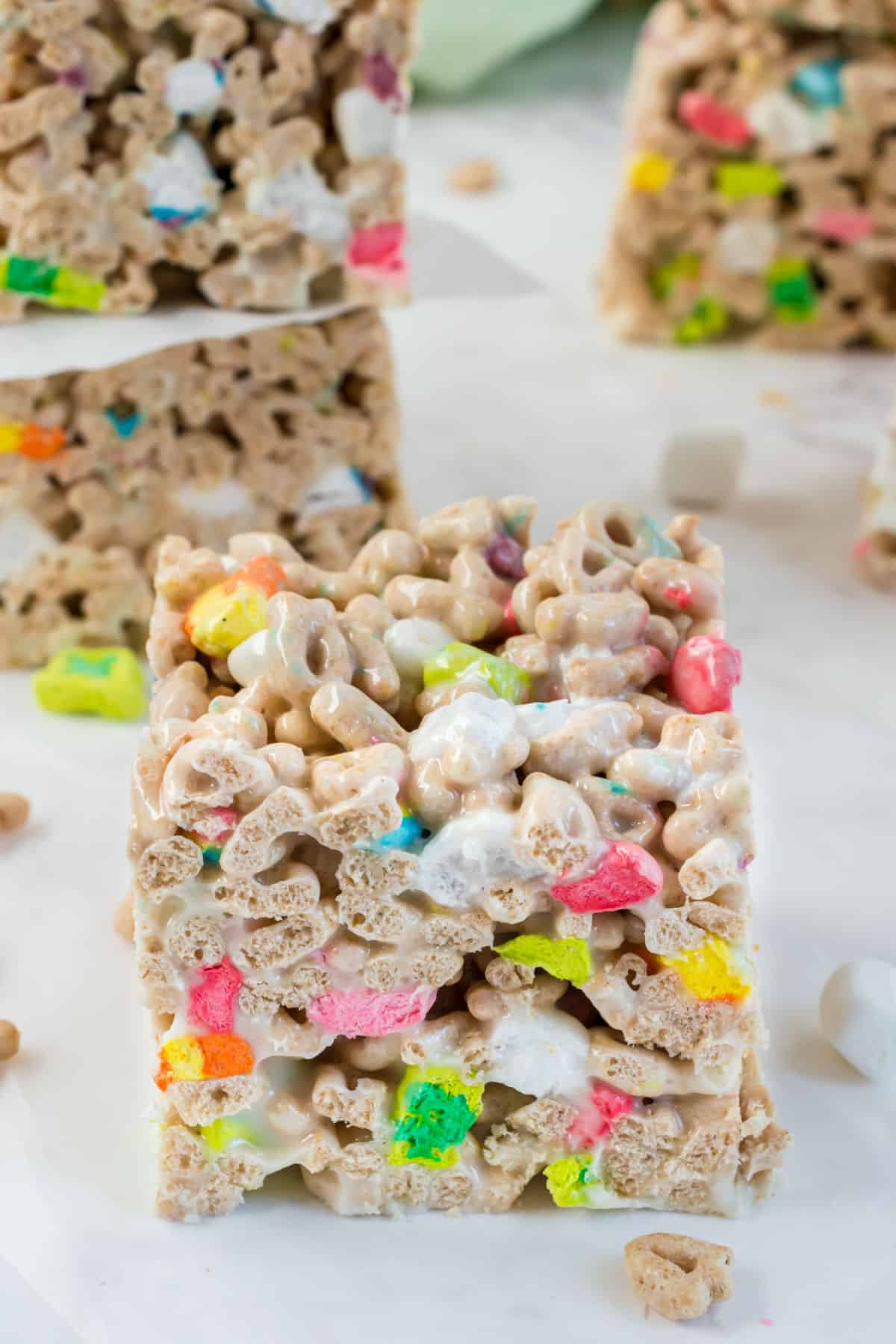 Lucky charms treats bars cut into thick squares.