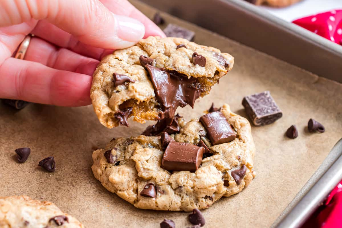 Gooey chocolate chips in a broken chocolate chunk cookie.