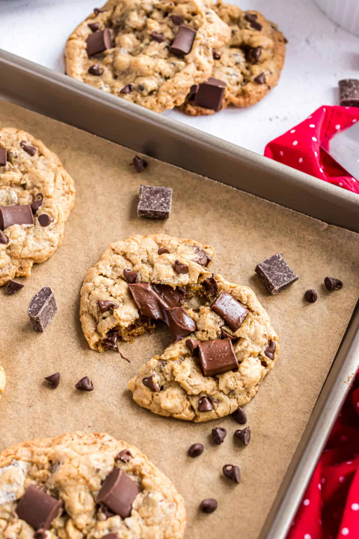 Oatmeal chocolate chunk cookie on a parchment paper lined cookie sheet.