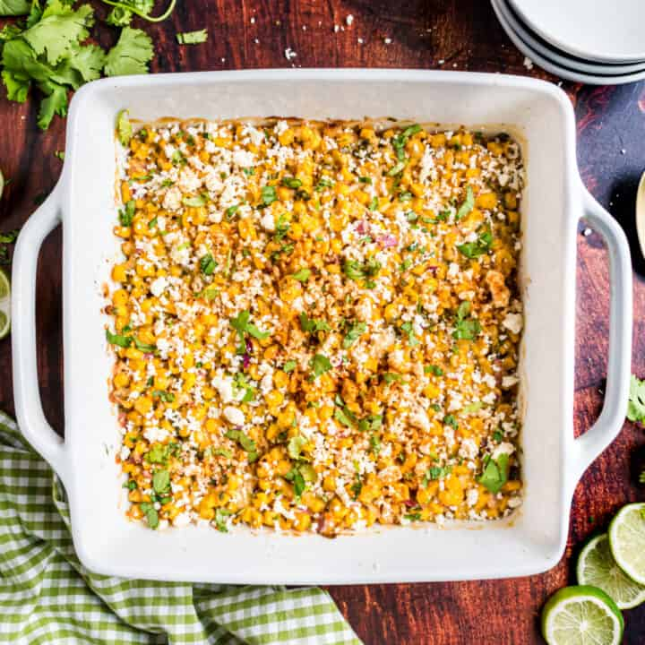 Mexican street corn salad baked in a square dish.