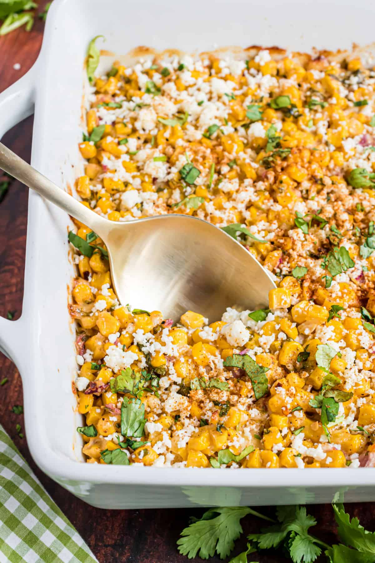 Mexican street corn salad baked in square dish.