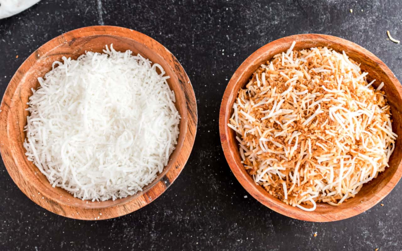 Two bowls of coconut, one is toasted.