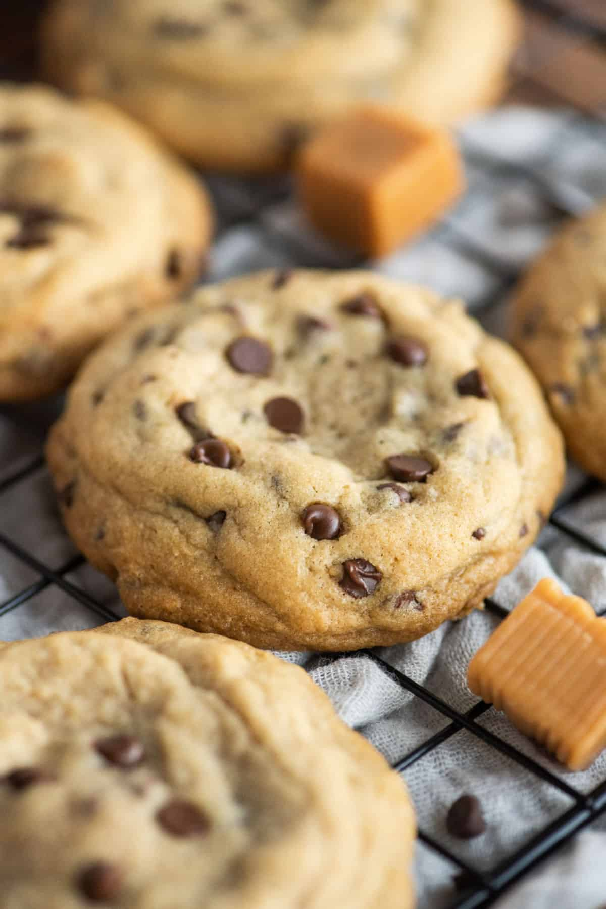 Caramel stuffed chocolate chip cookies on wire rack to cool.