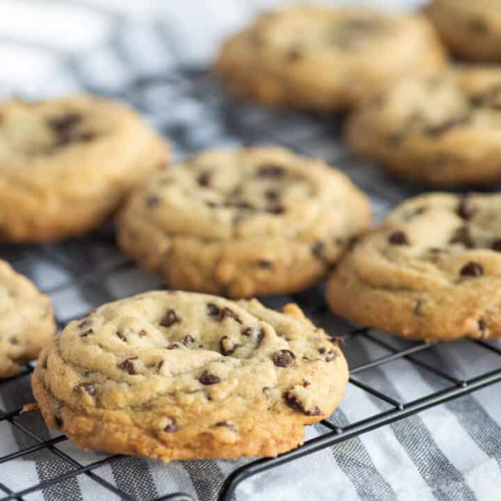 Caramel stuffed chocolate chip cookies on cooling rack.