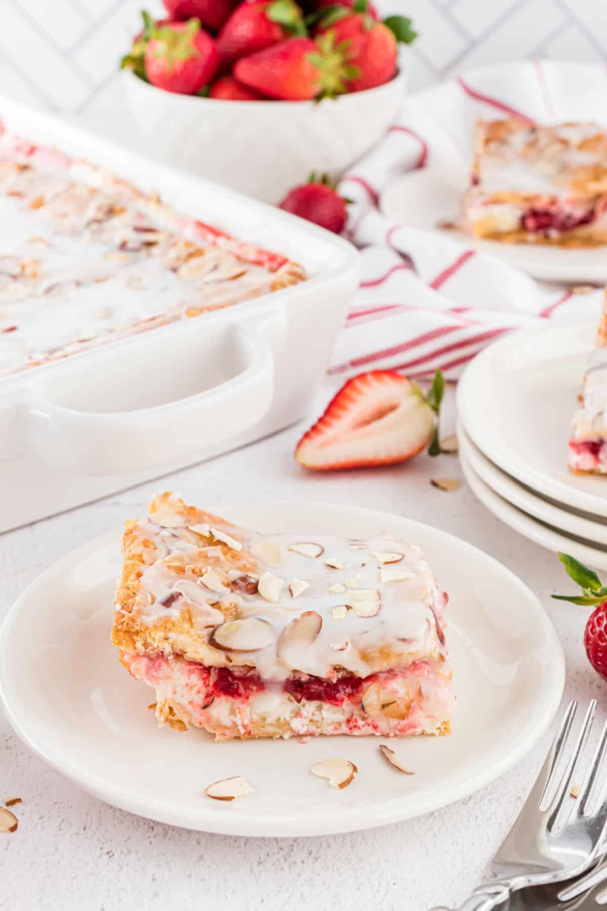 Strawberry danish slice on a white plate.