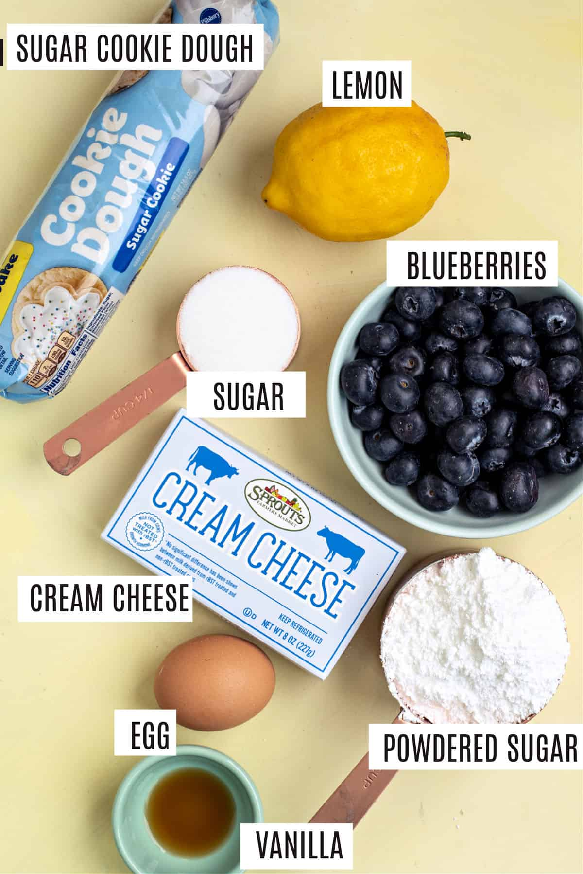 Ingredients needed for blueberry cheesecake sugar cookie bars.