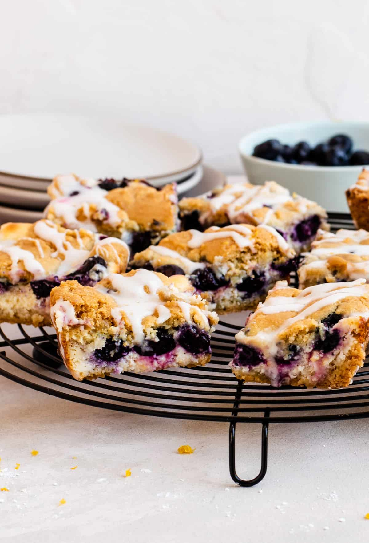 Blueberry cheesecake sugar cookie bars are round wire rack.