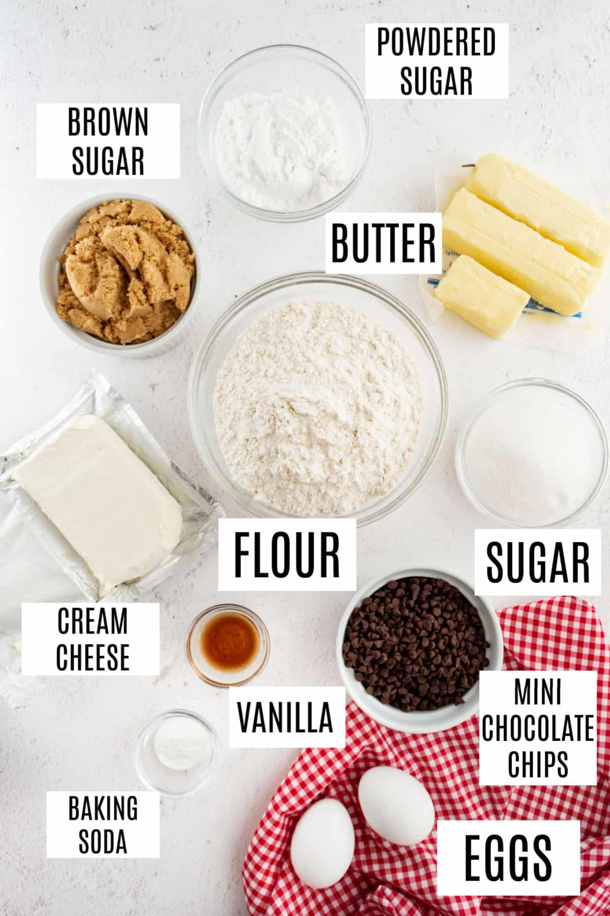 Ingredients needed to make chocolate chip cheesecake cookies.
