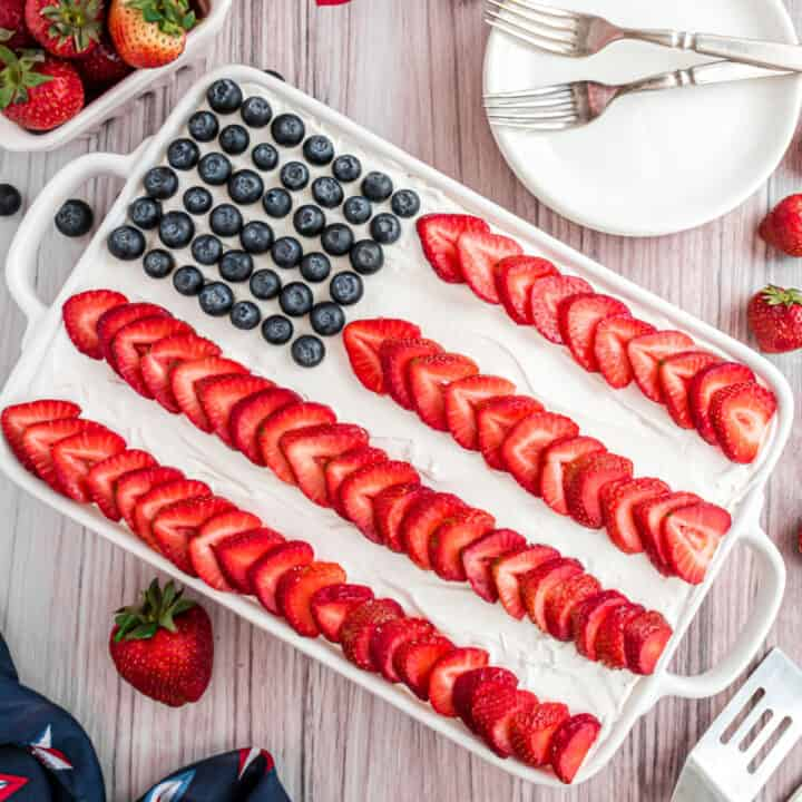 Celebrate Independence Day with this eye catching Flag Cake. Whipped cream and fresh berries make this stars-and-stripes dessert a crowd pleaser. Let this cake be the sweet finish for your Fourth of July meal!