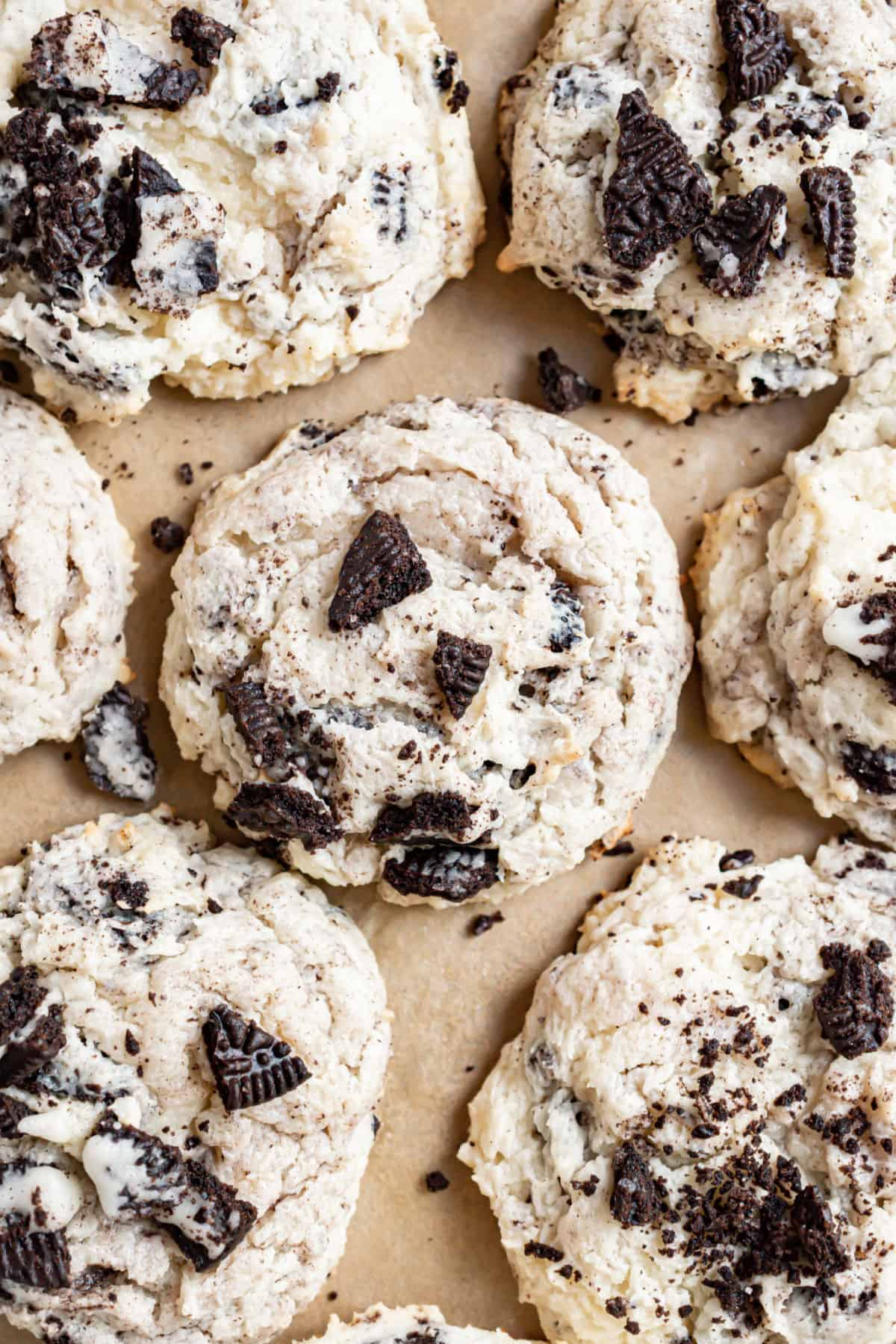 Oreo cheesecake cookies on parchment paper.