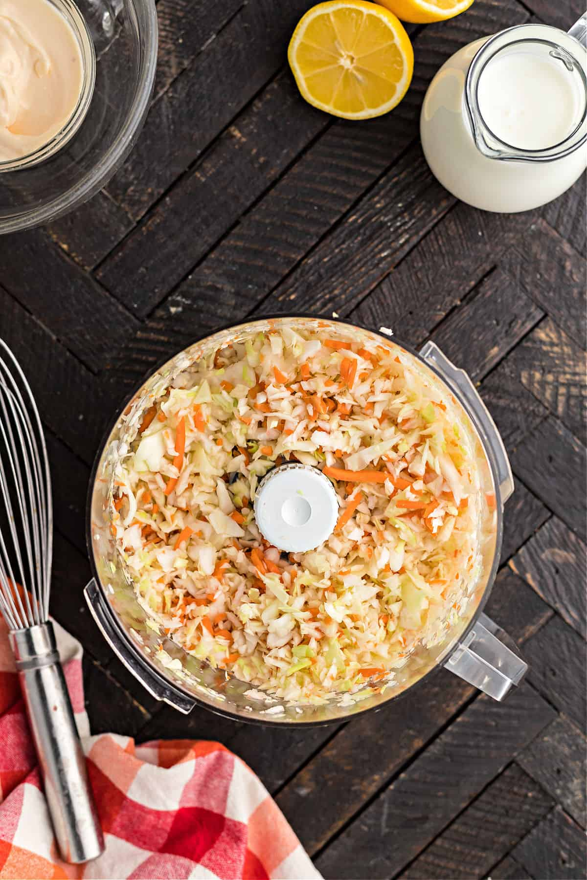 Carrots and cabbage in food processor shredded.