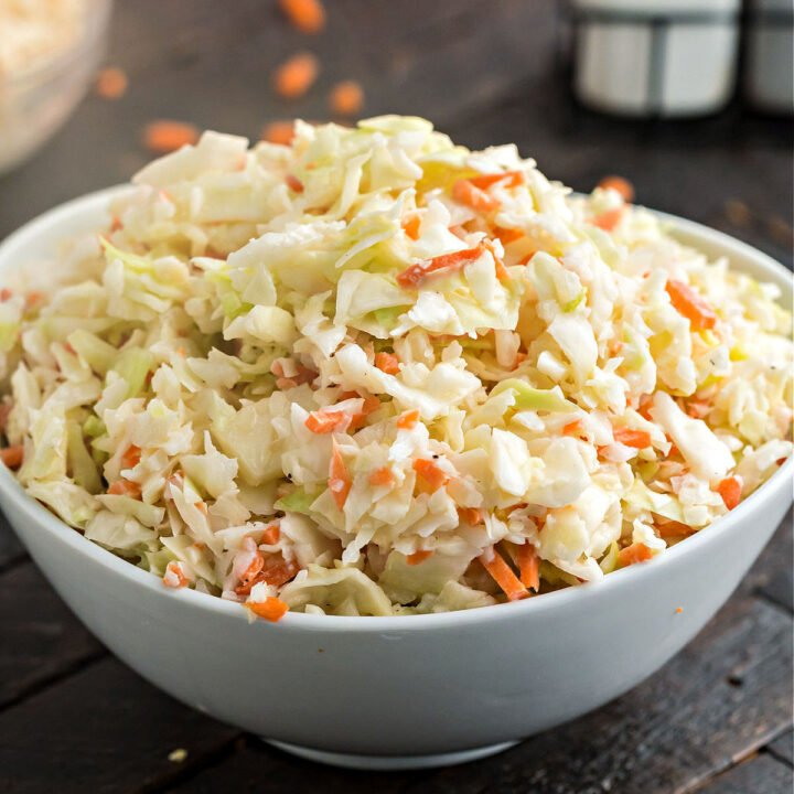 Make copycat KFC Coleslaw that's better than the original! Everyone's favorite fried chicken side dish is easy to replicate at home. This fresh coleslaw has a tangy buttermilk dressing that keeps you coming back for more.