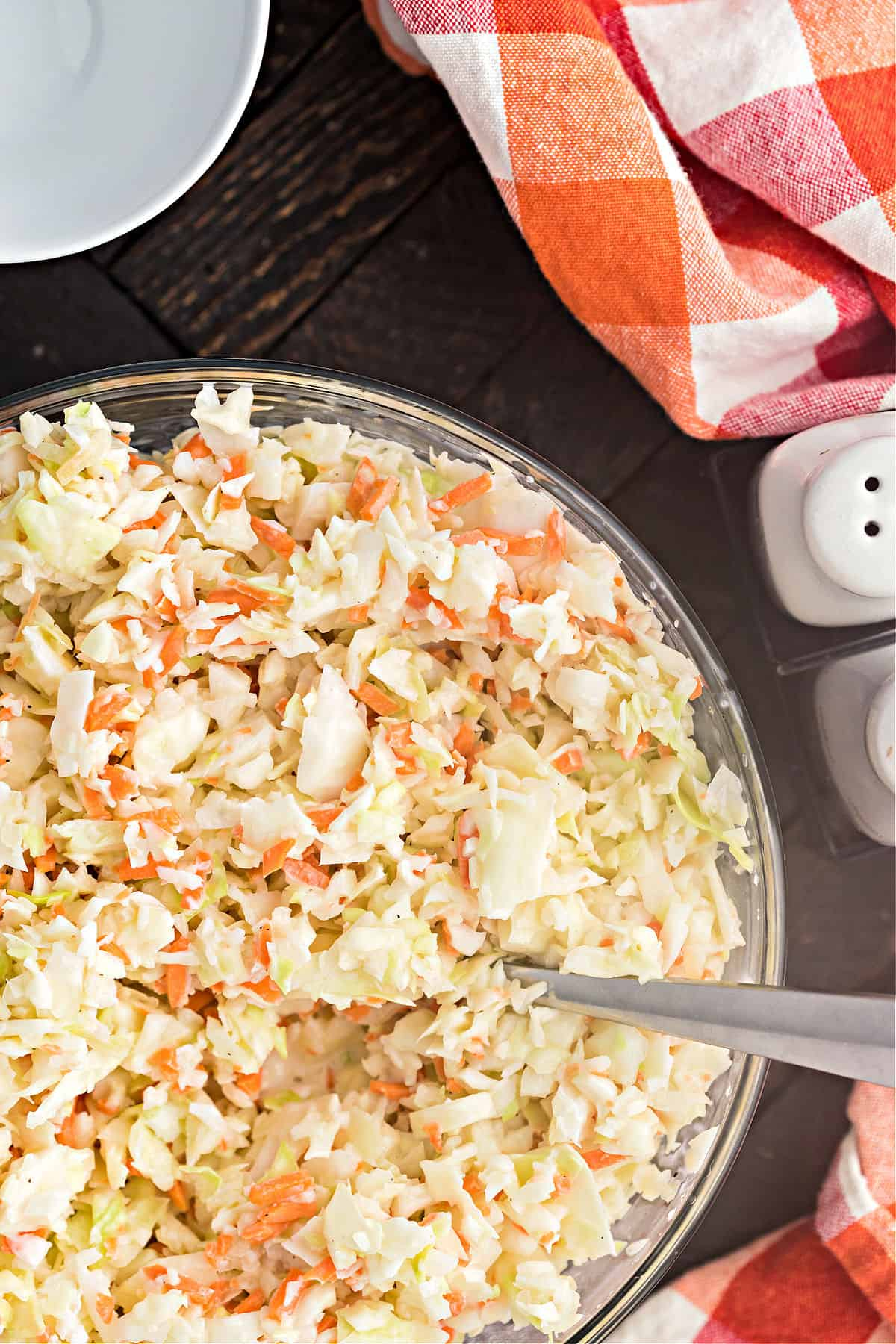 Coleslaw in a serving bowl with spoon.