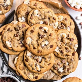Large plate stacked with smores cookies.