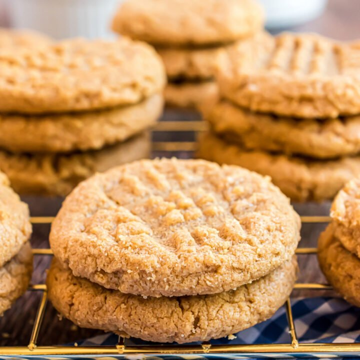 Stacks of peanut butter cookies on wire cooling rack.