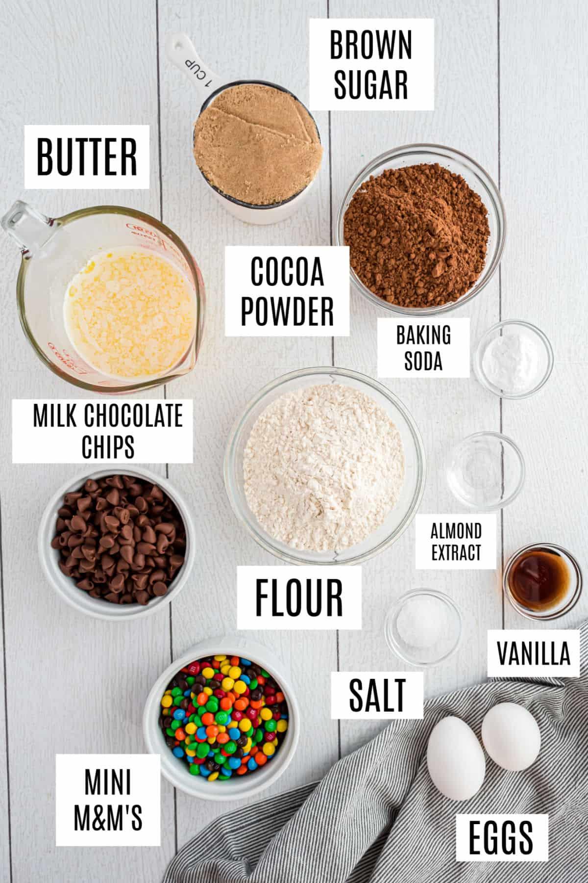 Ingredients needed to make chocolate m&ms cookies.