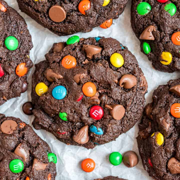 Chocolate M&M cookies on parchment paper.