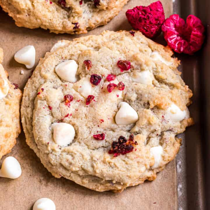 White chocolate chip cookie with raspberries.