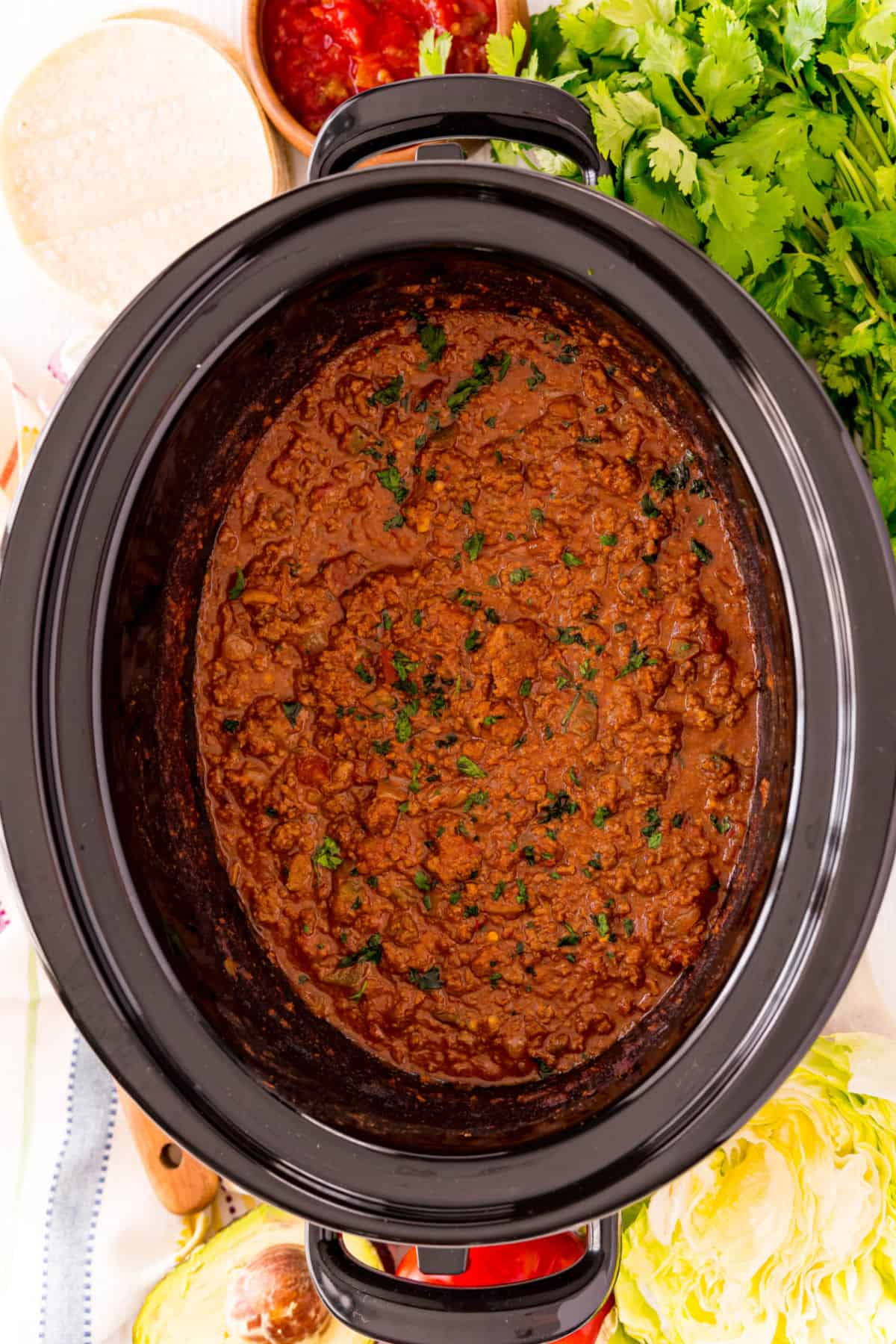 Cooked taco meat in slow cooker.