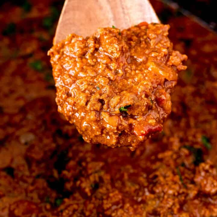 Slow cooker taco meat on a wooden spoon.