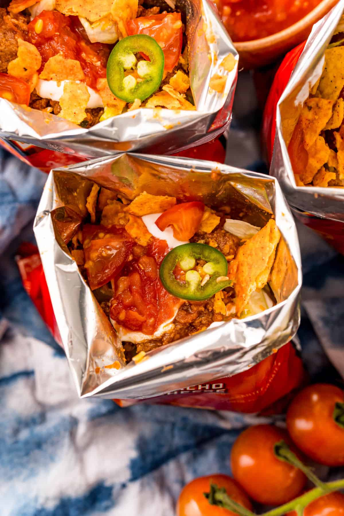 Bags of doritos with taco filling inside.