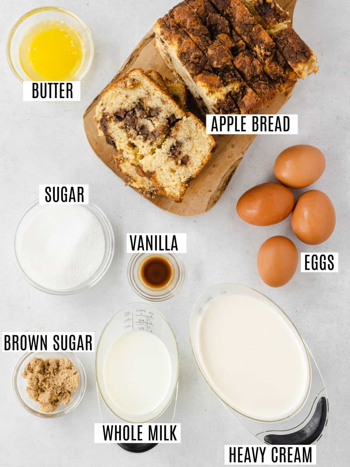 Ingredients needed to make apple bread pudding.