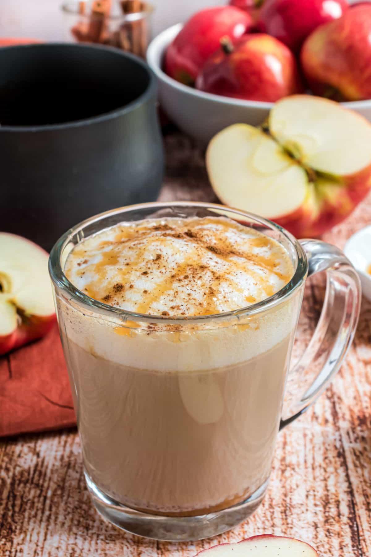 Copycat starbucks apple crisp macchiato in a clear glass mug.