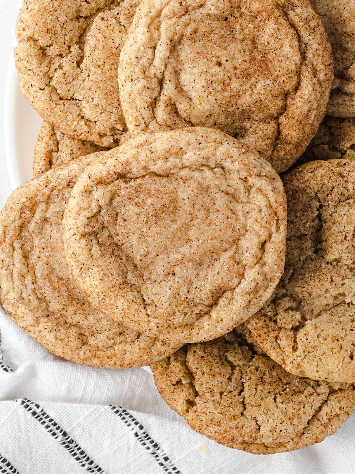 Chai spiced cookies on a plate stacked.