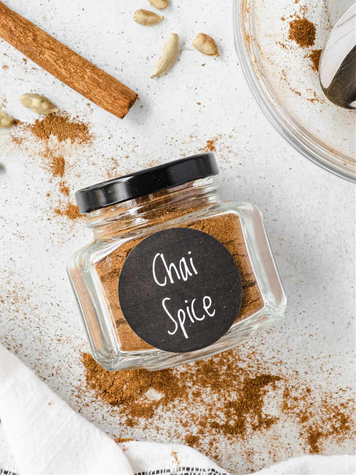 Homemade chai spice mix in a small jar.