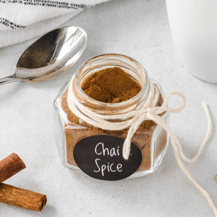 Homemade chai spices in a small jar.